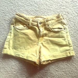 Beautiful faded yellow denim jean shorts.